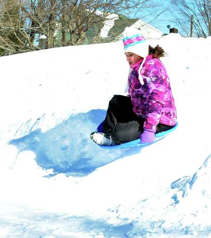 Alexandria Wilson, 10, goes over a jump while sledding  at Broadview Middle School in Danbury, Sunday, Feb. 10, 2013. Photo: Michael Duffy / The News-Times