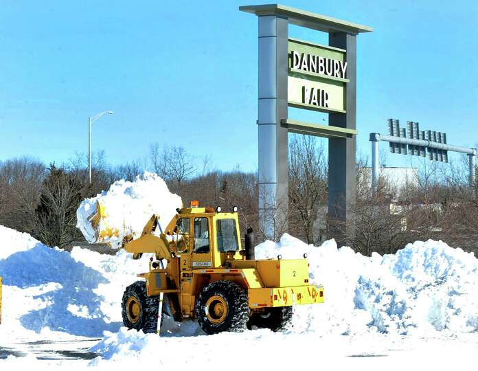 Snow removal creates huge mounds of the white stuff at the Danbury Fair mall in Danbury, Sunday, Feb
