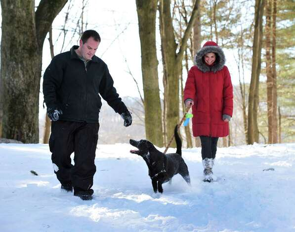 Nathan Archer and Rebecca Goetz walk Biern at Tarrywile Park  in Danbury, Sunday, Feb. 10, 2013. Photo: Michael Duffy / The News-Times