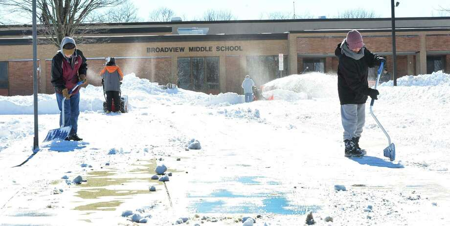 Workers clear snow outside Broadview Middle School  in Danbury, Sunday, Feb. 10, 2013. Photo: Michael Duffy / The News-Times