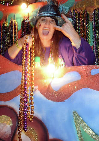 Krewe members throw beads to a ecstatic crowd down Proctor Street in Port Arthur during the Total Krewe of Aurora Parade on Saturday, February 9, 2013. Photo taken: Randy Edwards/The Enterprise Photo: Randy Edwards