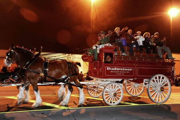 The Budweiser clydesdales parade down Proctor Street in Port Arthur during the Total Krewe of Aurora Parade on Saturday, February 9, 2013. Photo taken: Randy Edwards/The Enterprise Photo: Randy Edwards