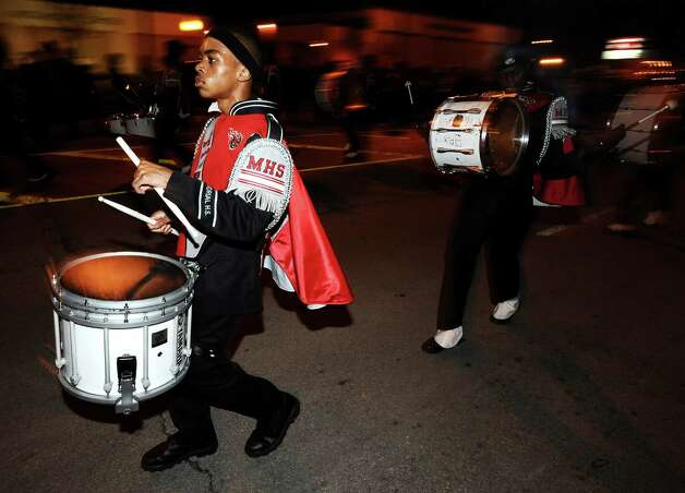 Port Arthur Memorial band members parade down Proctor Street in Port Arthur during the Total Krewe of Aurora Parade on Saturday, February 9, 2013. Photo taken: Randy Edwards/The Enterprise Photo: Randy Edwards