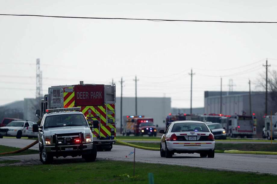 Firefighters respond to an explosion and fire at the Air Liquide plant at 11450 W. Fairmont Pkwy where one person was injured and another missing Friday, Feb. 8, 2013, in Houston. 