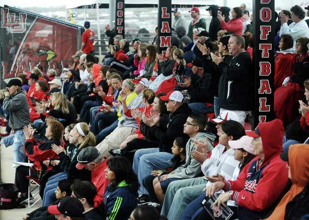 Lamar fans cheer on the Cardinals during the Lamar University softball game against UTSA at Ford Park on Saturday, February 9, 2013.  Lamar won over UTSA 3-2. Photo taken: Randy Edwards/The Enterprise Photo: Randy Edwards