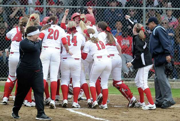 Lamar softball team greets player Candyce Carter, #3, at the plate on her home run in the bottom of the second inning of the Lamar University softball game against UTSA at Ford Park on Saturday, February 9, 2013.  Lamar won over UTSA 3-2. Photo taken: Randy Edwards/The Enterprise Photo: Randy Edwards