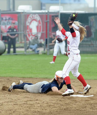 Lamar player Casey Cromwell, #11, looks to make a double play during the Lamar University softball game against UTSA at Ford Park on Saturday, February 9, 2013.  Lamar won over UTSA 3-2. Photo taken: Randy Edwards/The Enterprise Photo: Randy Edwards