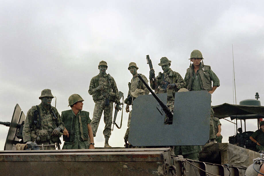 The US Navy SEALs have a rich history, but they were formally formed in the early 60s during the Vietnam conflict.In this image provided by the U.S. Navy, members of U.S. Navy Seal Team One move down the Bassac River in a Seal Team Assault Boat (STAB) during operations in south of Saigon, Vietnam in January 1969. (AP Photo/U.S. Navy) Photo: Uncredited, ASSOCIATED PRESS / AP1969