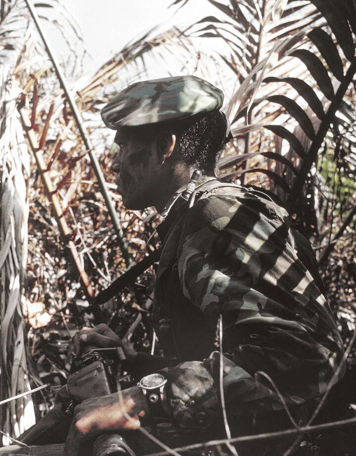In this image provided by the U.S. Navy, member of U.S. Navy Seal Team moves down a jungle river bank on a search and destroy operation in the Mekong Delta Republic in Vietnam in January 1969. (AP Photo/U.S. Navy) Photo: Uncredited, ASSOCIATED PRESS / AP1969