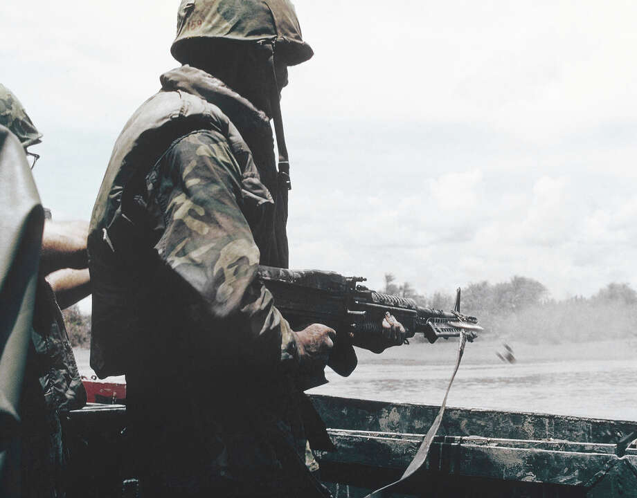 In this image provided by the U.S. Navy, members of U.S. Navy Seal Team One move down the Bassac River in a Seal Team Assault Boat (STAB) during operations in south of Saigon, Vietnam in January 1969. (AP Photo/U.S. Navy) Photo: Uncredited, ASSOCIATED PRESS / AP1969
