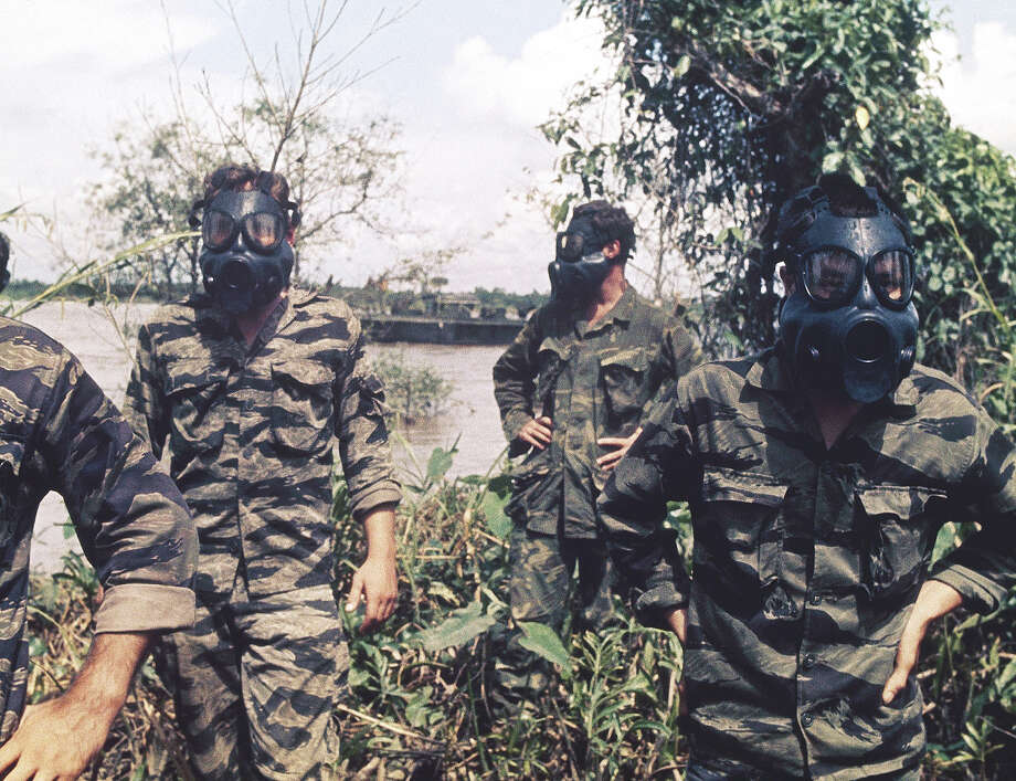 In this image provided by the U.S. Navy, members of U.S. Navy Seal Team move down a jungle river bank on a search and destroy operation  in the Mekong Delta Republic in Vietnam in January 1969. (AP Photo/U.S. Navy) Photo: Uncredited, ASSOCIATED PRESS / AP1969