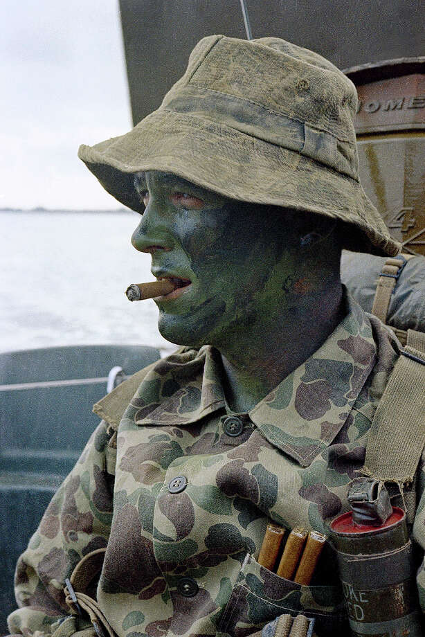 "In this image provided by the U.S. Navy, member of U.S. Navy Seal Team shown in a converted ""mike"" boat as it pulls toward a jungle river bank for a search and destroy operation in the Mekong Delta Republic in Vietnam in January 1969. (AP Photo/U.S. Navy) Photo: Uncredited, ASSOCIATED PRESS / AP1969"