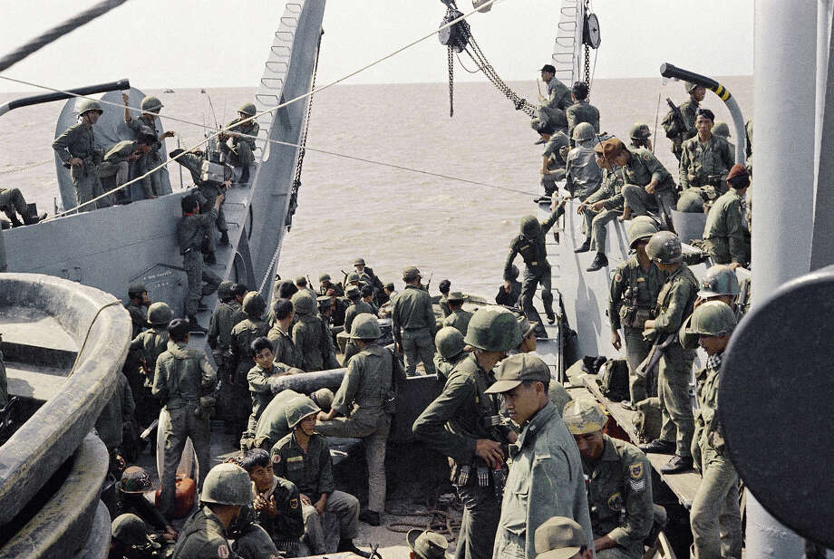 In this image provided by the U.S. Navy, a well armed converted ìmikeî boat pulls toward a jungle river bank to dispatch a platoon of Navy seals on a search and destroy operation in the Mekong Delta Republic in Vietnam in January 1969. (AP Photo/U.S. Navy) Photo: Uncredited, ASSOCIATED PRESS / AP1969