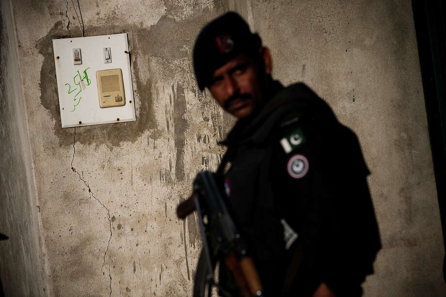 A Pakistani policeman stands next to the intercom at the entrance to the compound where Osama Bin Laden was killed in an operation by US Navy Seals, on May 4, 2011, in Abottabad, Pakistan. Bin Laden was killed during a U.S. military mission on May 2, at the compound. The Obama administration have decided not to release photographs of Bin Laden's body. Photo: Warrick Page, Getty Images / 2011 Warrick Page