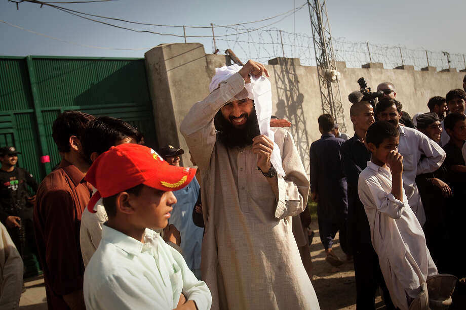 A man entertaining a crowd of media and locals pretends to be Osama Bin Laden outside the compound where Osama Bin Laden was reportedly killed in an operation by US Navy Seals, on May 3, 2011, in Abottabad, Pakistan. Bin Laden was killed during a U.S. military mission on May 2, at the compound. The Obama administration have decided not to release photographs of Bin Laden's body. Photo: Warrick Page, Getty Images / 2011 Warrick Page