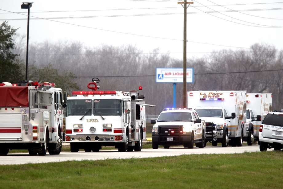 Dozens of emergency officials and personnel respond to the blaze. (Johnny Hanson/Chronicle)