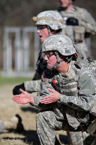 Pfc. Katrina Welnicki, 20, of Newburgh, N.Y., who's taking the medic training, can run two miles in 13 minutes, 45 seconds and do 83 situps and 68 pushups in two minutes. Those figures are good enough to not only meet the Army's perfect physical fitness score, but to easily beat it. Photo: Jerry Lara, San Antonio Express-News / San Antonio Express-News