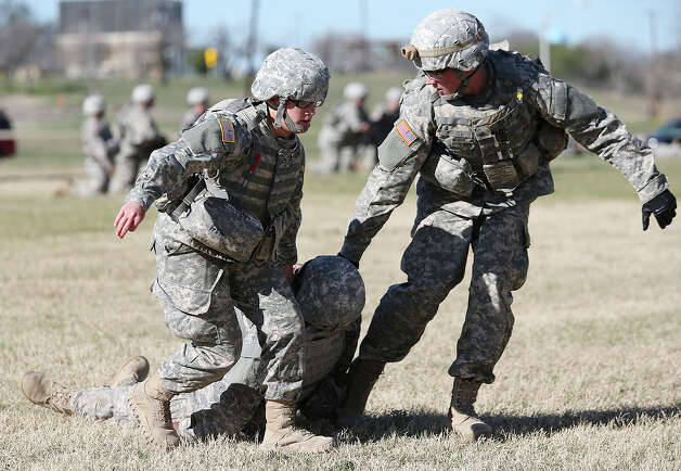 Pfc. Katrina Welnicki, 20, left, of Newburgh, N.Y. and Pvt. Kristopher Teague, 19, of Palm Springs, Calif. go through medic training at Fort Sam Houston, Thursday, Jan. 31, 2013. They are part of the Ft. Sam Houston 232nd Medical Battalion and undergo 16 weeks of training. Women make up one in five of the 2,600 soldiers going through the training. Photo: Jerry Lara, San Antonio Express-News / San Antonio Express-News