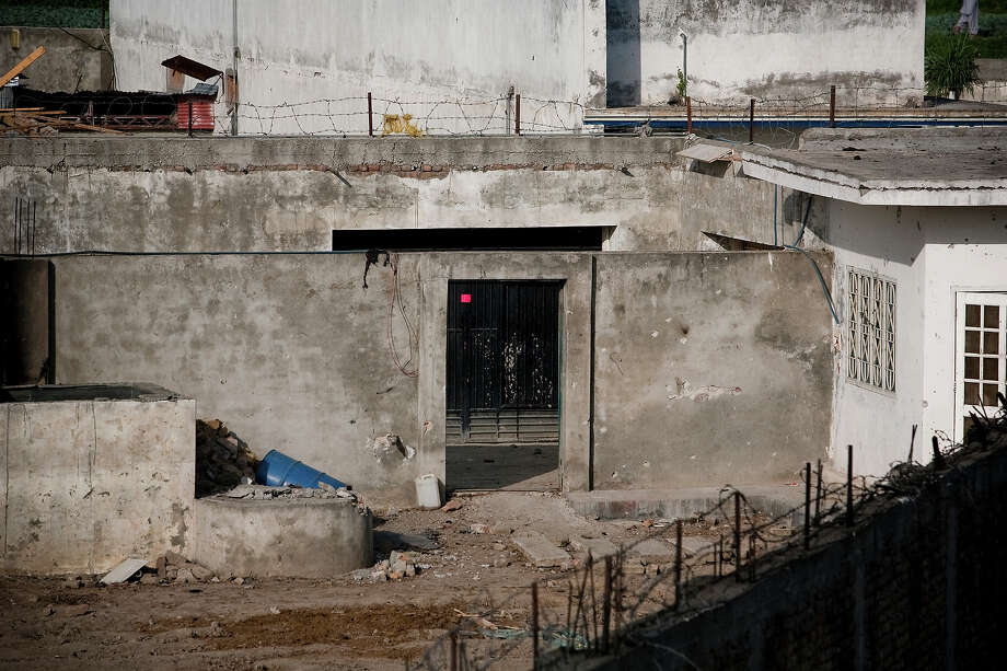 A damaged courtyard is seen where a US helicopter was blown-up by US forces after crash-landing inside the compound where Osama Bin Laden was killed in an operation by US Navy Seals, on May 4, 2011, in Abottabad, Pakistan. Bin Laden was killed during a U.S. military mission on May 2, at the compound. The Obama administration have decided not to release photographs of Bin Laden's body. Photo: Warrick Page, Getty Images / 2011 Warrick Page