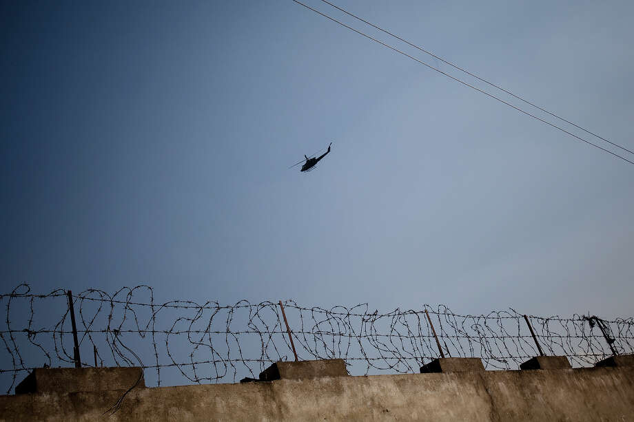 A Pakistani helicopter flies over the compound where Osama Bin Laden was killed in an operation by US Navy Seals, on May 4, 2011, in Abottabad, Pakistan. Bin Laden was killed during a U.S. military mission on May 2, at the compound. The Obama administration have decided not to release photographs of Bin Laden's body. Photo: Warrick Page, Getty Images / 2011 Warrick Page