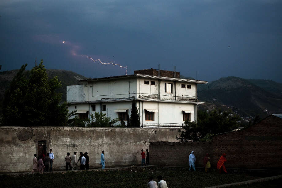 Lightening strikes in the distance beyond the compound where Osama Bin Laden was killed in an operation by US Navy Seals, on May 4, 2011, in Abottabad, Pakistan. Bin Laden was killed during a U.S. military mission on May 2, at the compound. The Obama administration have decided not to release photographs of Bin Laden's body. Photo: Warrick Page, Getty Images / 2011 Warrick Page