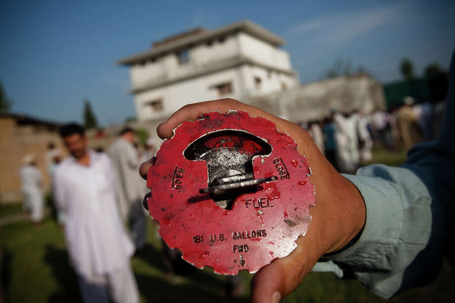A local man displays a fuel cap believed to come from the US helicopter that was reportedly shot down outside the compound where Osama Bin Laden was killed in an operation by US Navy Seals, on May 3, 2011, in Abottabad, Pakistan.  Bin Laden was killed during a U.S. military mission on May 2, at the compound. The Obama administration have decided not to release photographs of Bin Laden's body. Photo: Warrick Page, Getty Images / 2011 Warrick Page