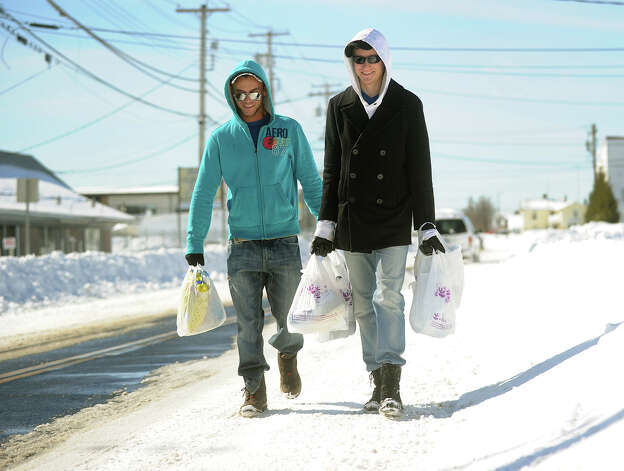 Tom LeConte, left, and Joe Leck of Milford walk two miles each way to carry groceries to their snowed in apartment complex in Milford, Conn. on Sunday, February 10, 2013. Photo: Brian A. Pounds / Connecticut Post