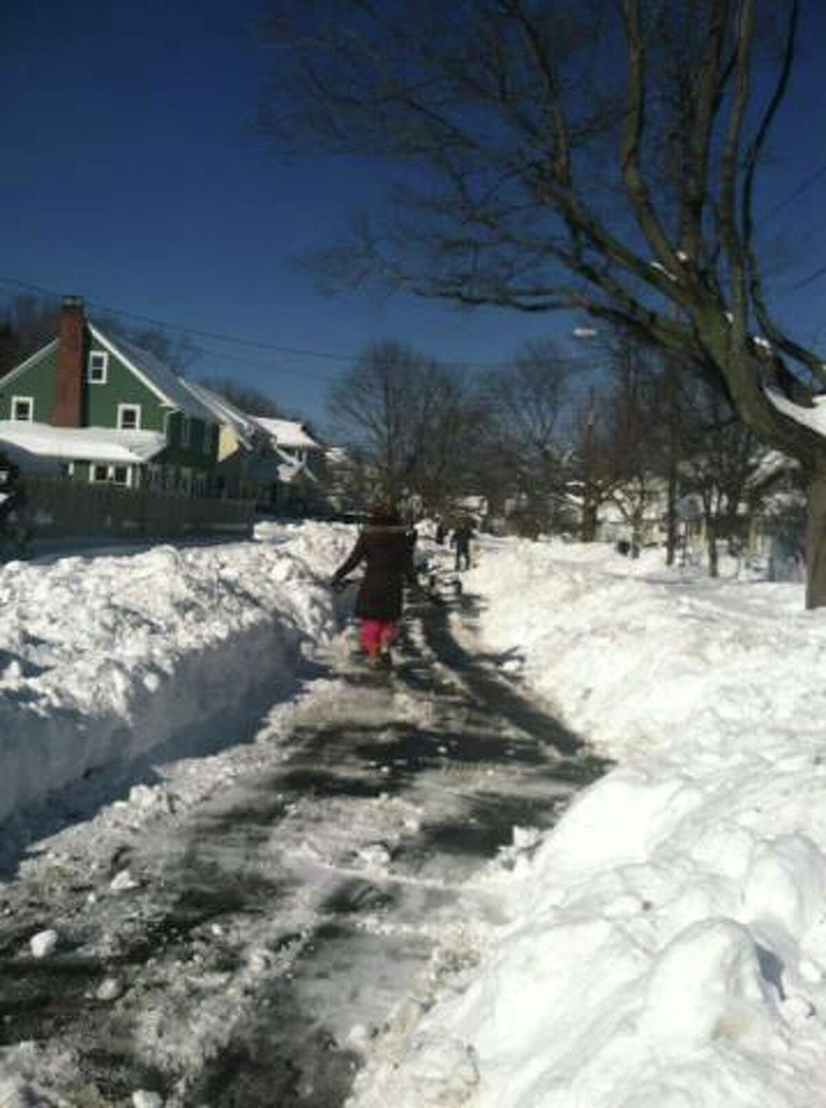 Facebook user Ann Darby Roberts posted these photos Sunday, Feb. 13, 2013, of Fayerweather Terrace residents clearing their street.