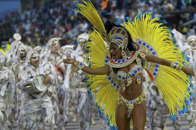 A dancer from the Imperio de Casa Verde samba school performs during a carnival parade on Sunday in Sao Paulo, Brazil. Photo: AP