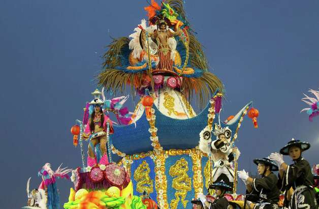 Dancers from the Imperio de Casa Verde samba school perform on a float during a carnival parade on Sunday in Sao Paulo, Brazil. Photo: AP