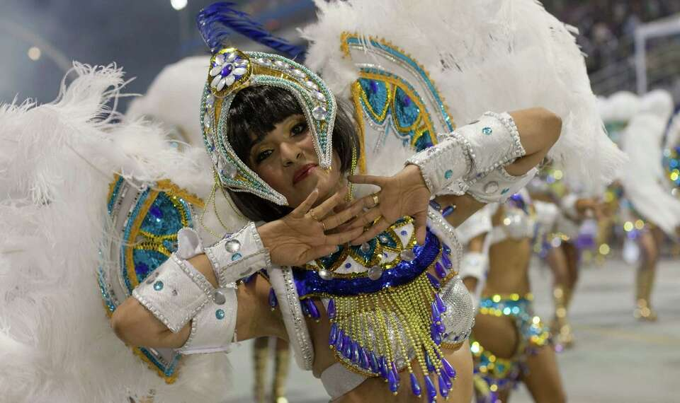 A dancer from the Imperio de Casa Verde samba school performs during a carnival parade on Sunday in