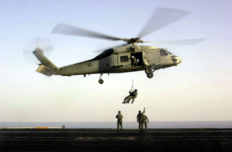 "396169 14: US Navy SEALs train with an SH-60F ""Seahawk"" helicopter October 18, 2001 on the flight deck of USS Enterprise. Aircraft from the Enterprise are being used to attack targets within Afghanistan. Photo: U.S. Navy, Getty Images / Getty Images North America"