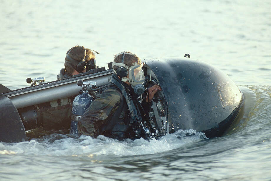 Navy SEALs, part of US Special Forces train using a submersible delivery vehicle. Photo: Greg Mathieson/Mai, Time & Life Pictures/Getty Image / Greg Mathieson/Mai