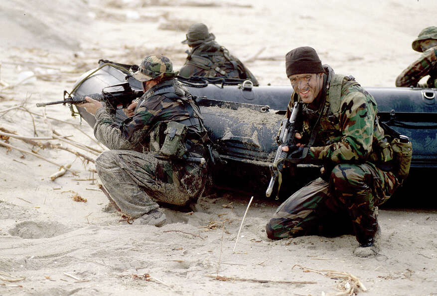 Navy SEAL team, part of US Special Forces train for a beach landing.