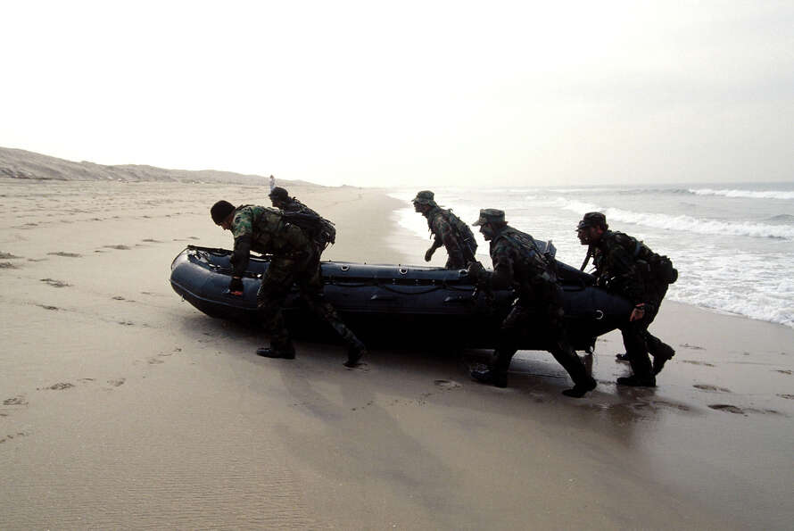 Navy SEALs, part of US Special Forces, train for a beach landing.