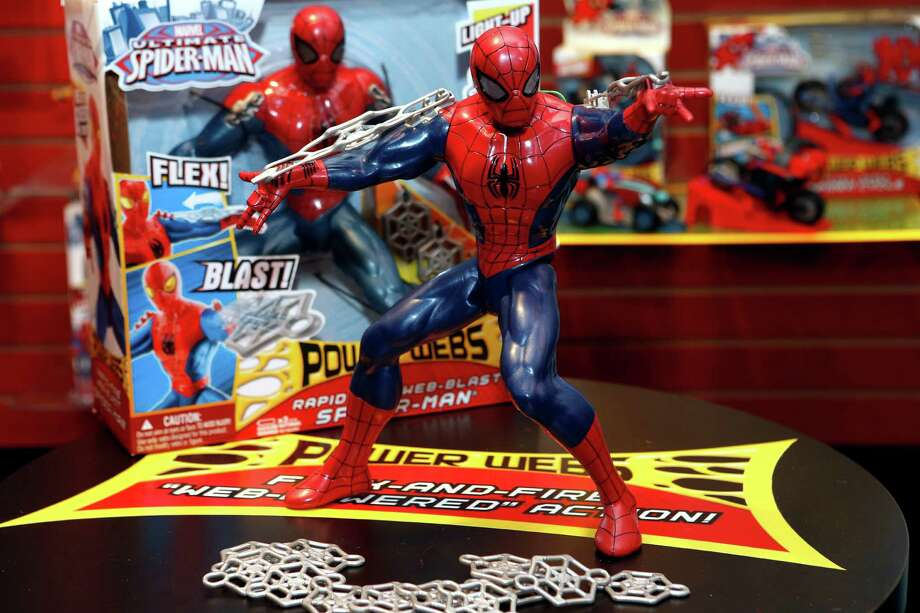 Hasbro's new POWER WEBS RAPID FIRE WEB BLAST SPIDER-MAN, standing at over 12-inches tall and featuring kid-powered, rapid-fire, web-shooting action, is displayed in Hasbro's showroom at the American International Toy Fair, Saturday, Feb. 9, 2013, in New York. (Photo by Jason DeCrow/Invision for Hasbro/AP Images) Photo: Jason DeCrow, Associated Press / Invision