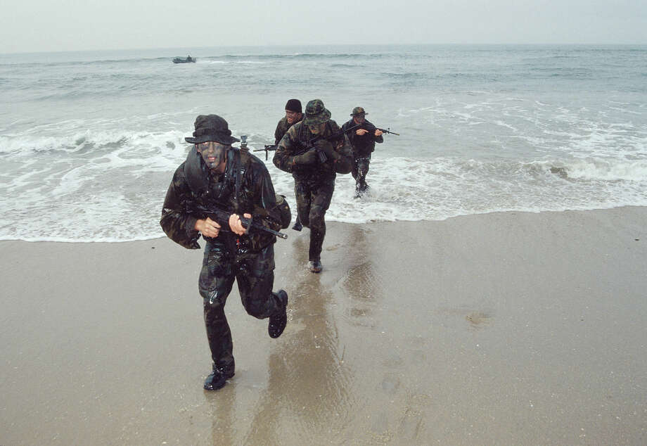 Navy SEALs, part of US Special Forces, train for a beach landing. Photo: Greg Mathieson/Mai, Time & Life Pictures/Getty Image / Greg Mathieson/Mai