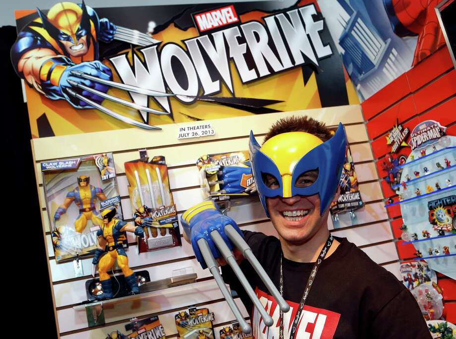 "Toy demonstrator Clayton Hodges dons the ""Wolverine Hero Mask"" and ""Wolverine Electronic Claw,"" based on the Marvel Comics character featured in the upcoming film ""The Wolverine"" in Hasbro's showroom at the American International Toy Fair, Saturday, Feb. 9, 2013, in New York. (Photo by Jason DeCrow/Invision for Hasbro/AP Images) Photo: Jason DeCrow, Associated Press / Invision"
