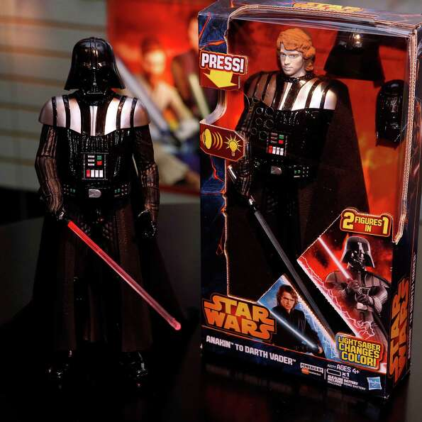 These two figures are actually one — Hasbro's STAR WARS ANAKIN TO VADER FIGURE action figure, wh