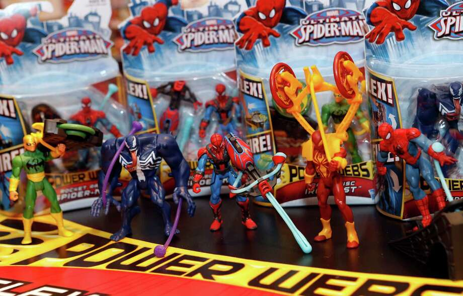 The line of Hasbro's ULTIMATE SPIDER-MAN POWER WEBS FEATURE FIGURES — based on the Ultimate Spider-Man TV show and each including a stretchy accessory to power the figure's action — is displayed in the company's showroom at the American International Toy Fair, Saturday, Feb. 9, 2013, in New York. (Photo by Jason DeCrow/Invision for Hasbro/AP Images) Photo: Jason DeCrow, Associated Press / Invision