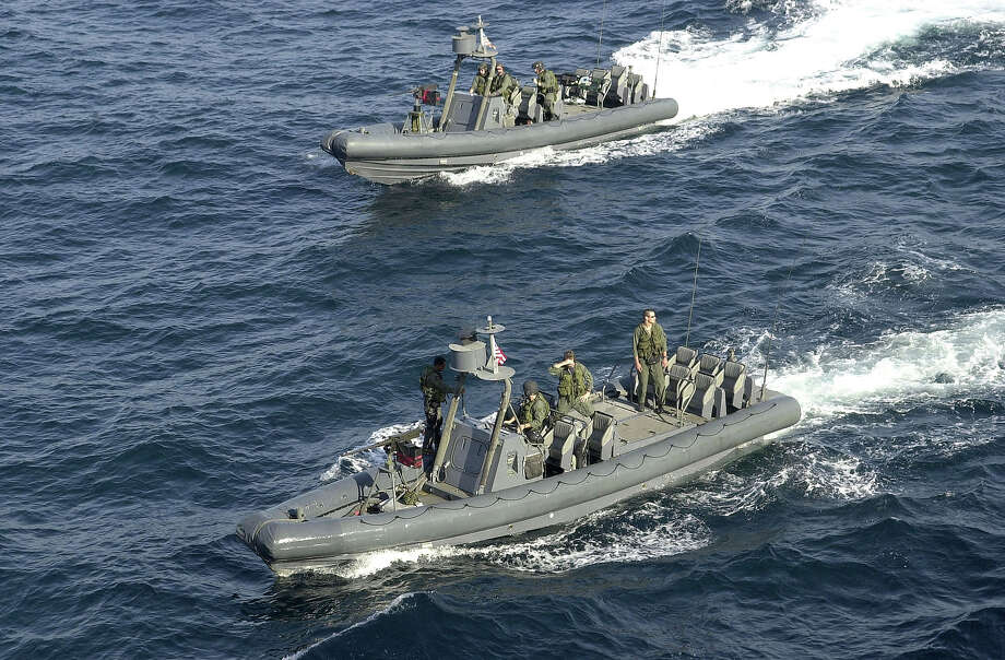 Two U.S. Navy Special Warfare Rigid-Hull Inflatable Boats (NSW RHIBs) deploying fr. the amphibious warfare ship USS Shreveport (LPD 12) to pick up SEAL team members during interdiction operations exercise. The exercise simulates boarding a ship that maybe carrying terrorist suspects. The NSW craft and personnel are deployed in support of Operation Enduring Freedom. Photo: Mai, Time & Life Pictures/Getty Image / /Mai