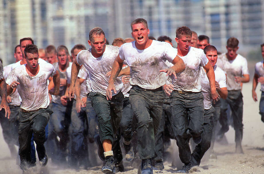 Navy Seal trainees rush the beach under orders in this undated photo taken in 2000 at the Coronado Naval Amphibious Base in San Diego, California. Photo: Joe McNally, Getty Images / 2000 Joe McNally