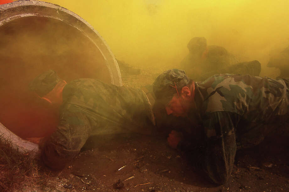 Navy Seal trainees prepare to crawl through a tunnel under simulated wartime conditions in this undated photo taken in 2000 at the Coronado Naval Amphibious Base in San Diego, California. Photo: Joe McNally, Getty Images / 2000 Joe McNally