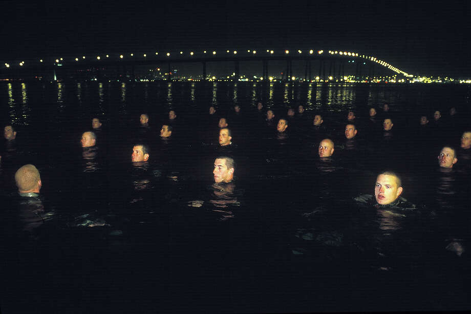 Navy Seal trainees stand in the frigid waters of the Pacific in this undated photo taken in 2000 at the Coronado Naval Amphibious Base in San Diego, California. Photo: Joe McNally, Getty Images / 2000 Joe McNally