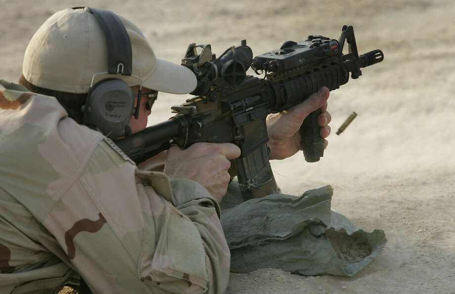 A U.S. Navy SEAL fires his M-4 assault rifle during a training session with Iraqi army scouts July 26, 2007 in Fallujah, Iraq. Photo: John Moore, Getty Images / 2007 Getty Images