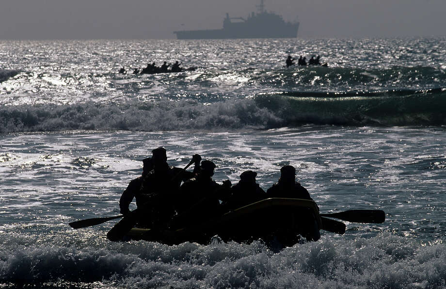 Navy Seal trainees, aboard rafts, head towards the mothership in August of 2005 during Hell Week at a beach in Coronado, California. Photo: Joe McNally, Getty Images / 2005 Joe McNally