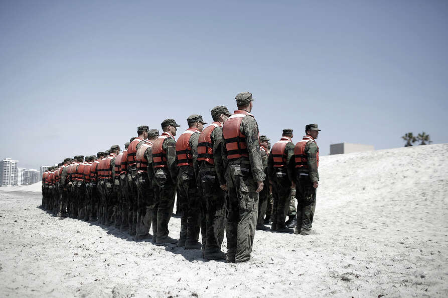 A group of Navy Seal trainees in August of 2010 during Hell Week at a beach in Coronado, California.