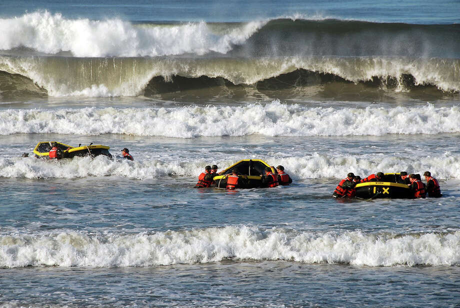 Students from Basic Underwater Demolition/SEAL (BUD/S) class 286 participate in a surf passage training exercise at Naval Amphibious Base Coronado October 27, 2010 in Coronado, California. Surf passage is one of many physically demanding evolutions that are part of First Phase training at BUD/S. Photo: U.S. Navy, Getty Images / 2010 US Navy