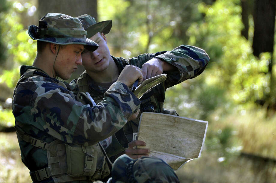 Students from Basic Underwater Demolition/SEAL (BUD/S) class 284 participate in a land navigation training exercise Otober 27, 2010 in Mt. Laguna, California. Photo: U.S. Navy, Getty Images / 2010 US Navy