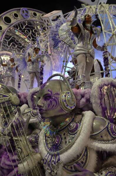 Members of the samba school Mocidade Alegre dance during the second day of carnival parade at the An